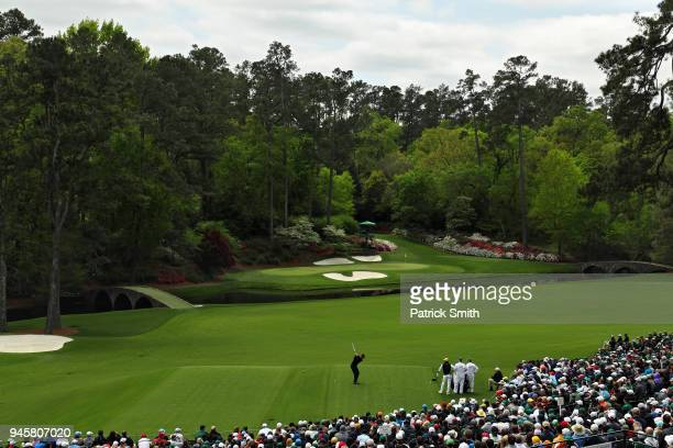Tiger Woods of the United States plays his first shot from the 12th hole during the final round of the 2018 Masters Tournament at Augusta National...