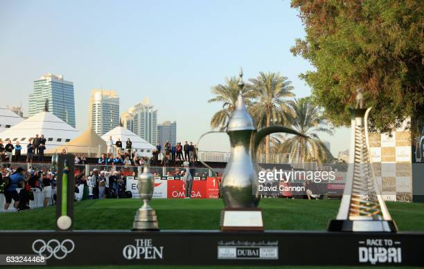Tiger Woods of the United States plays his first tee shot over Henrik Stenson's silver medal from the 2016 Rio Olympics and his 2016 Open...
