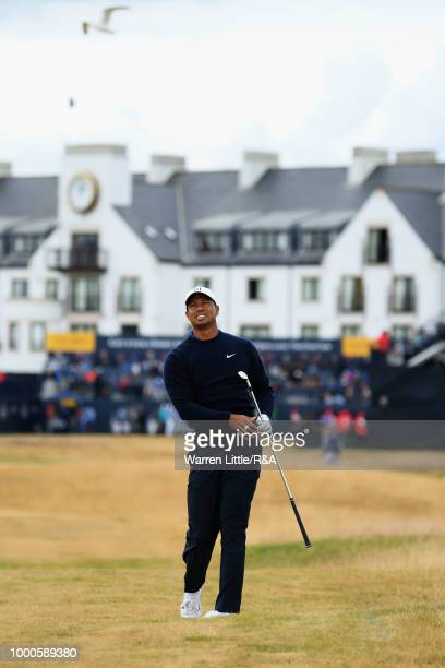 Tiger Woods of the United States plays his second shot at the 1st hole while practicing during previews to the 147th Open Championship at Carnoustie...