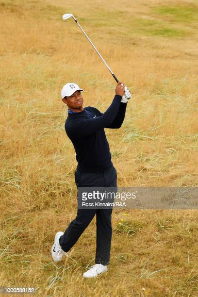 Tiger Woods of the United States plays his second shot at the 2nd hole while practicing during previews to the 147th Open Championship at Carnoustie...