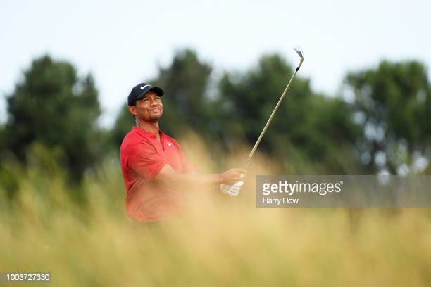 Tiger Woods of the United States plays his second shot from the rough on the seventh hole during the final round of the 147th Open Championship at...