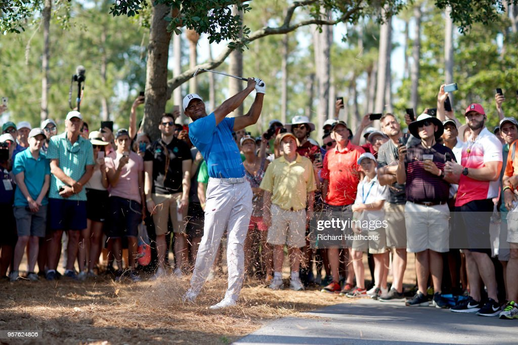 Tiger Woods of the United States plays his second shot on the 11th hole during the first round of THE PLAYERS Championship on the Stadium Course at TPC Sawgrass on May 10, 2018 in Ponte Vedra Beach, Florida.