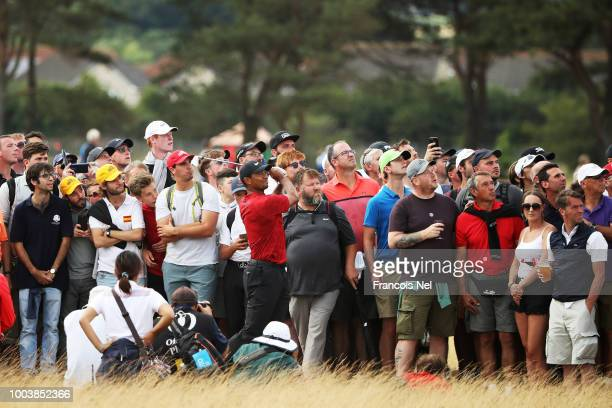Tiger Woods of the United States plays his second shot on the 14th hole during the final round of the 147th Open Championship at Carnoustie Golf Club...