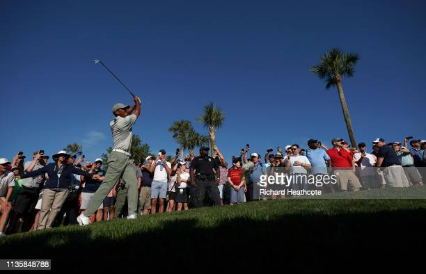 Tiger Woods of the United States plays his second shot on the 14th hole during the first round of The PLAYERS Championship on The Stadium Course at...