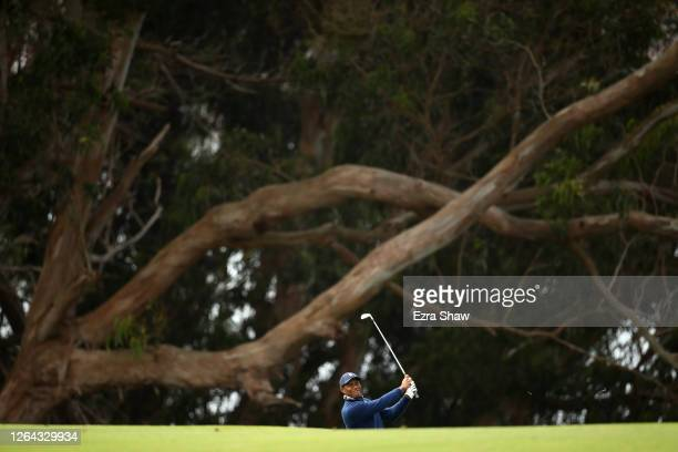 Tiger Woods of the United States plays his second shot on the 14th hole during the first round of the 2020 PGA Championship at TPC Harding Park on...