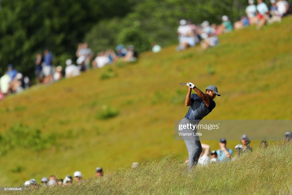 Tiger Woods of the United States plays his second shot on the 14th hole during the first round of the 2018 U.S. Open at Shinnecock Hills Golf Club on June 14, 2018 in Southampton, New York.