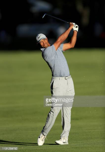 Tiger Woods of the United States plays his second shot on the 18th hole during the first round of World Golf Championships-Mexico Championship at...