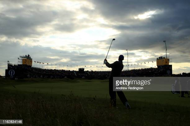 Tiger Woods of the United States plays his second shot on the 18th hole during the first round of the 148th Open Championship held on the Dunluce...