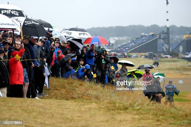 Tiger Woods of the United States plays his second shot on the 2nd hole during round two of the Open Championship at Carnoustie Golf Club on July 20...