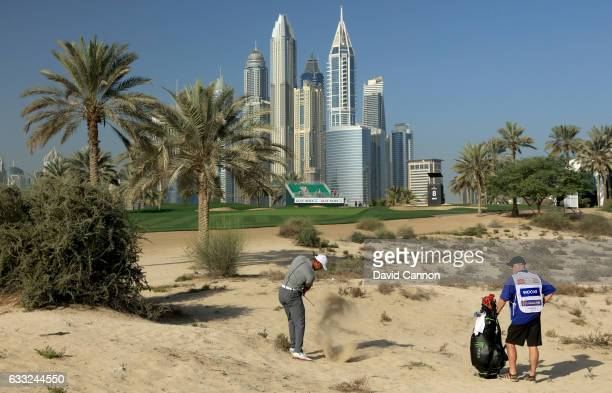 Tiger Woods of the United States plays his second shot on the eighth hole during the pro-am for the 2017 Omega Dubai Desert Classic on the Majlis...