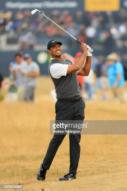 Tiger Woods of the United States plays his second shot on the first hole during the third round of the 147th Open Championship at Carnoustie Golf...