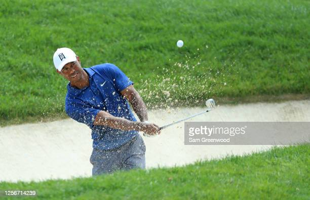Tiger Woods of the United States plays his second shot on the fourth hole during the second round of The Memorial Tournament on July 17 2020 at...