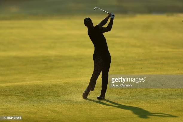 Tiger Woods of the United States plays his second shot on the ninth hole during the completion of the weather delayed second round of the 100th PGA...