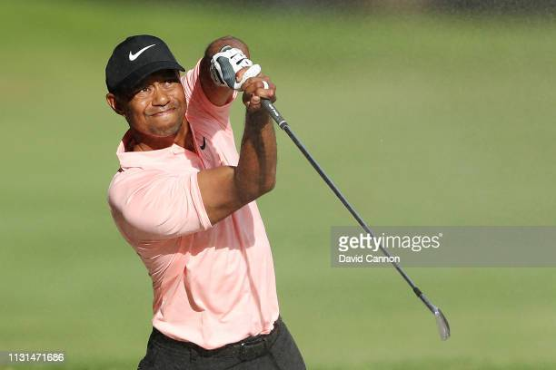 Tiger Woods of the United States plays his second shot on the ninth hole during the second round of World Golf ChampionshipsMexico Championship at...