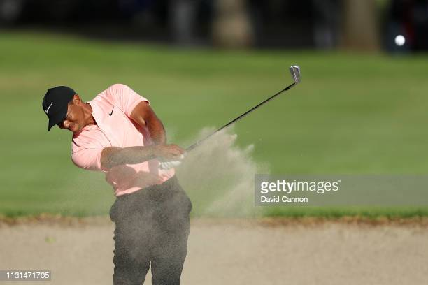 Tiger Woods of the United States plays his second shot on the ninth hole during the second round of World Golf Championships-Mexico Championship at...