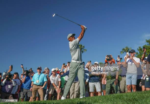 Tiger Woods of the United States plays his second shot on the par 4 14th hole during the first round of the 2019 Players Championship held on the...