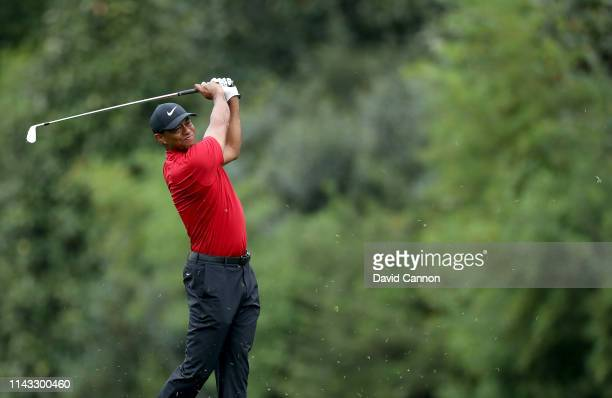 Tiger Woods of the United States plays his second shot on the par 4 fifth hole during the final round of the 2019 Masters Tournament at Augusta...
