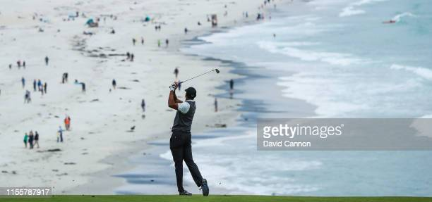 Tiger Woods of the United States plays his second shot on the par 4 ninth hole during the first round of the 2019 USOpen at the Pebble Beach Golf...