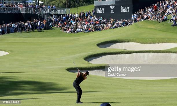 Tiger Woods of the United States plays his second shot on the par 4 second hole during the first round of the Genesis Invitational at the Riviera...