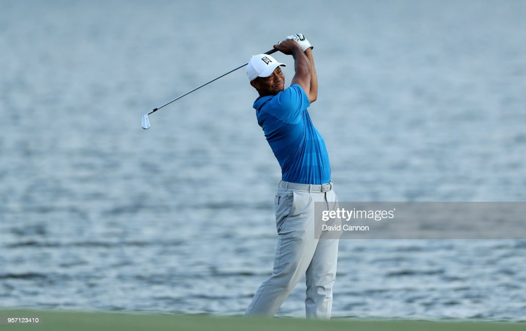 Tiger Woods of the United States plays his second shot on the par 4, 18th hole during the first round of the THE PLAYERS Championship on the Stadium Course at TPC Sawgrass on May 10, 2018 in Ponte Vedra Beach, Florida.