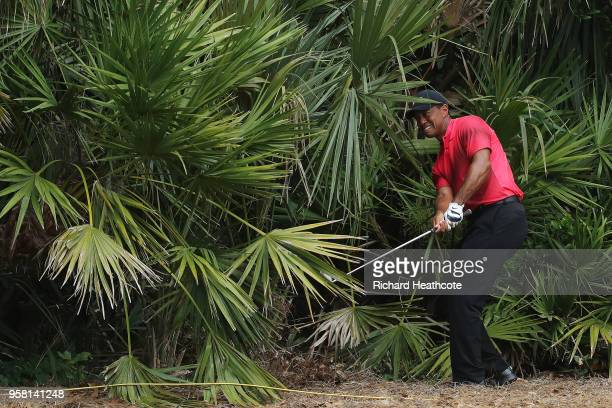 Tiger Woods of the United States plays his second shot on the second hole during the final round of THE PLAYERS Championship on the Stadium Course at...
