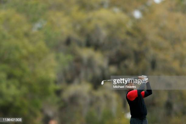 Tiger Woods of the United States plays his second shot on the sixth hole during the final round of The PLAYERS Championship on The Stadium Course at...