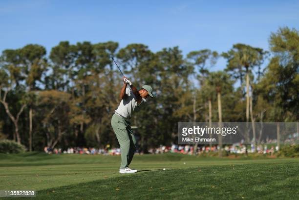Tiger Woods of the United States plays his second shot on the tenth hole during the first round of The PLAYERS Championship on The Stadium Course at...