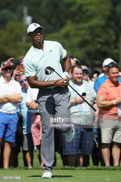 Tiger Woods of the United States plays his shot from the 11th tee during the first round of the BMW Championship at Aronimink Golf Club on September...
