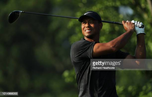 Tiger Woods of the United States plays his shot from the 12th tee during the continuation of the weather delayed second round of the 2018 PGA...