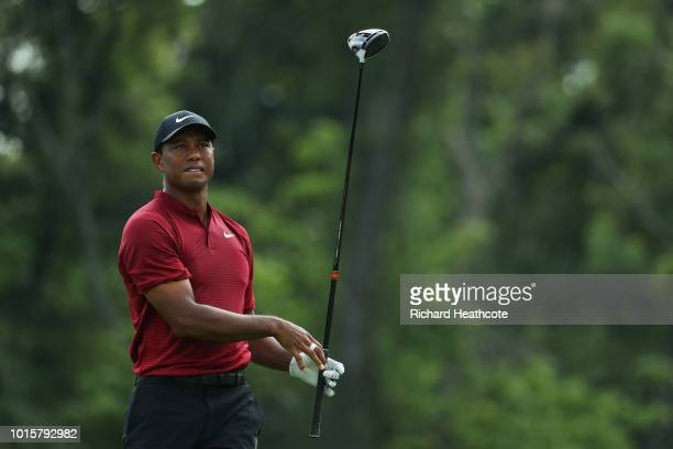 Tiger Woods of the United States plays his shot from the 12th tee during the final round of the 2018 PGA Championship at Bellerive Country Club on...