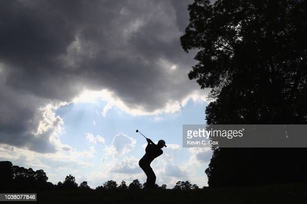Tiger Woods of the United States plays his shot from the 12th tee during the third round of the TOUR Championship at East Lake Golf Club on September...