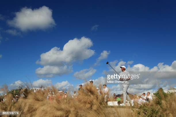 Tiger Woods of the United States plays his shot from the 12th tee during the second round of the Hero World Challenge at Albany Bahamas on December 1...