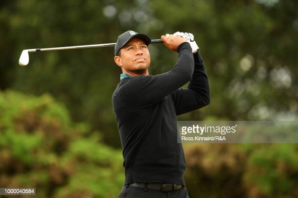 Tiger Woods of the United States plays his shot from the 13th tee while on a practice round during previews to the 147th Open Championship at...