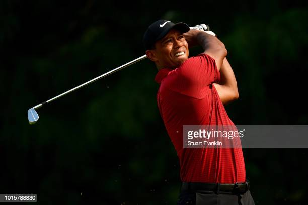 Tiger Woods of the United States plays his shot from the 13th tee during the final round of the 2018 PGA Championship at Bellerive Country Club on...