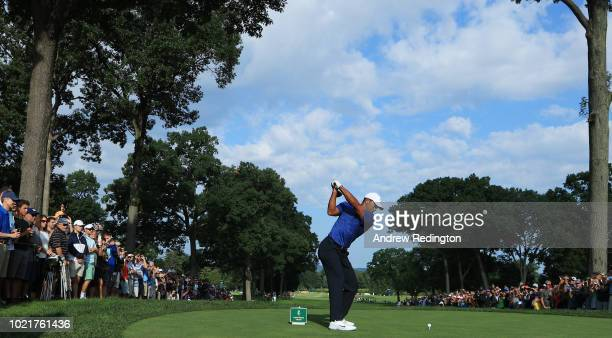 Tiger Woods of the United States plays his shot from the 13th tee during the first round of The Northern Trust on August 23 2018 at the Ridgewood...