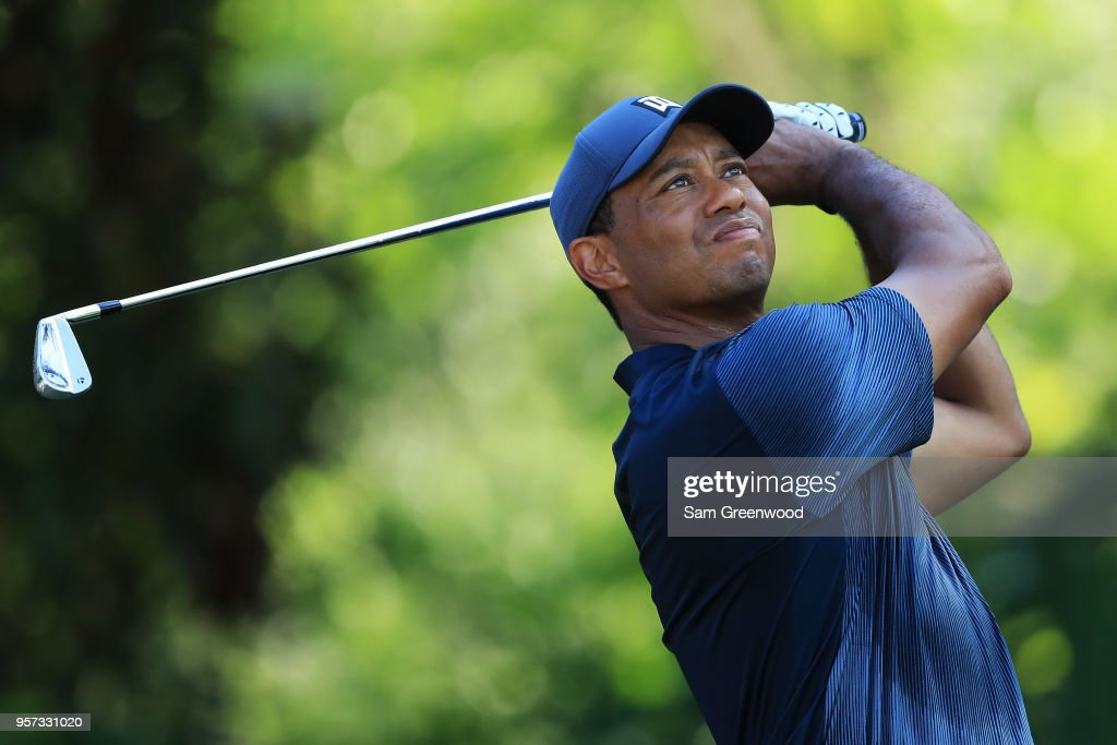 Simpson matches course record, Woods struggles to make cut at Players