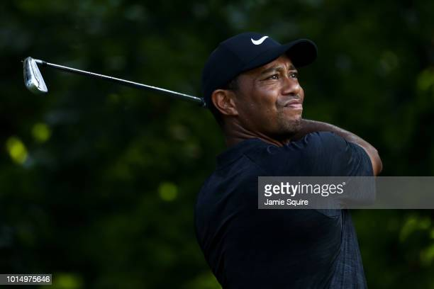 Tiger Woods of the United States plays his shot from the 14th tee during the continuation of the weather delayed second round of the 2018 PGA...