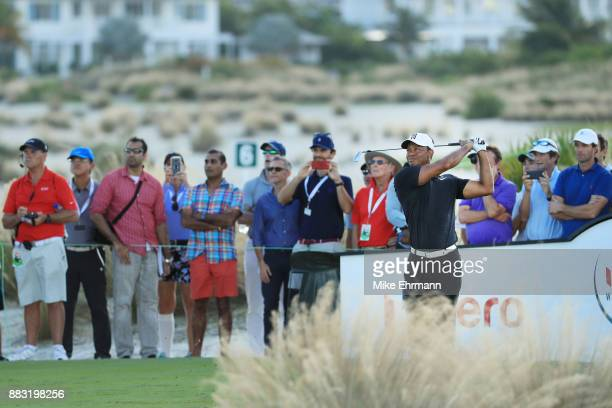 Tiger Woods of the United States plays his shot from the 14th tee during the first round of the Hero World Challenge at Albany Bahamas on November 30...
