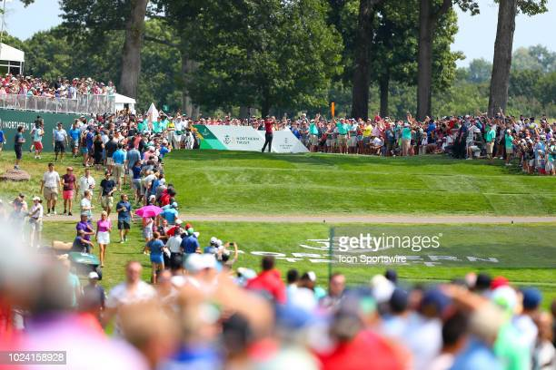 Tiger Woods of the United States plays his shot from the 16th tee during the Final Round of The Northern Trust on August 26 2018 at the Ridgewood...