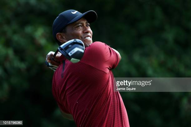 Tiger Woods of the United States plays his shot from the 18th tee during the final round of the 2018 PGA Championship at Bellerive Country Club on...