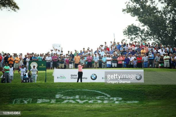 Tiger Woods of the United States plays his shot from the eighth tee during the second round of the BMW Championship at Aronimink Golf Club on...