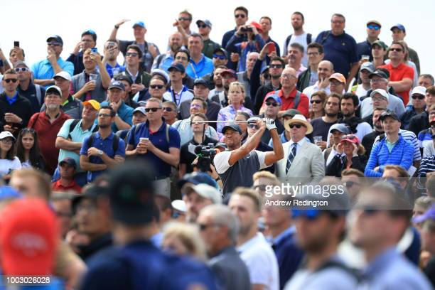 Tiger Woods of the United States plays his shot from the fifth tee during the third round of the 147th Open Championship at Carnoustie Golf Club on...
