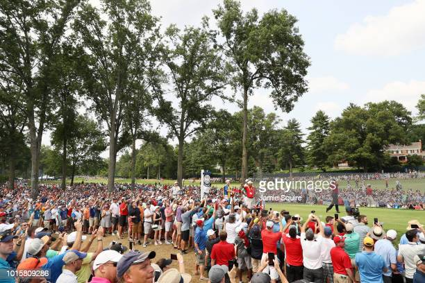 Tiger Woods of the United States plays his shot from the fifth tee during the final round of the 2018 PGA Championship at Bellerive Country Club on...