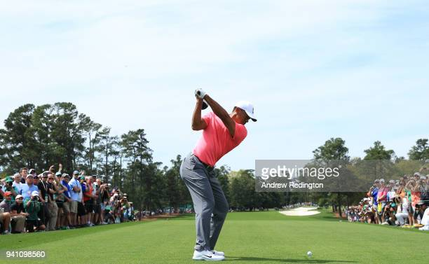Tiger Woods of the United States plays his shot from the first tee during a practice round prior to the start of the 2018 Masters Tournament at...