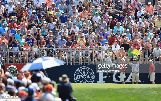 Tiger Woods of the United States plays his shot from the first tee during the second round of the 2018 PGA Championship at Bellerive Country Club on...