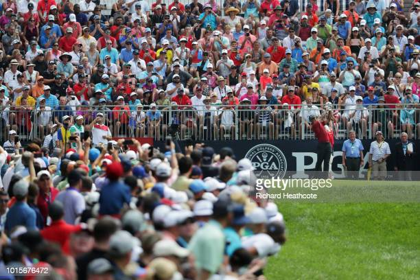 Tiger Woods of the United States plays his shot from the first tee during the final round of the 2018 PGA Championship at Bellerive Country Club on...