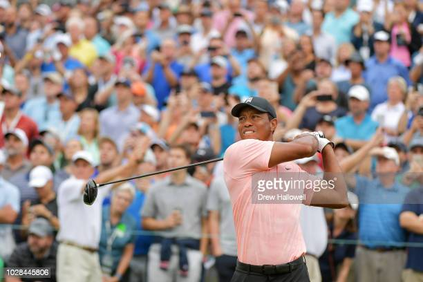 Tiger Woods of the United States plays his shot from the first tee during the second round of the BMW Championship at Aronimink Golf Club on...