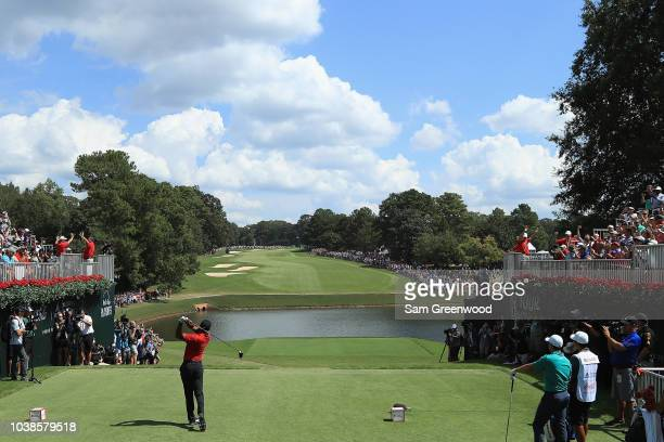 Tiger Woods of the United States plays his shot from the first tee during the final round of the TOUR Championship at East Lake Golf Club on...