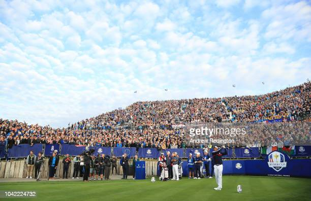 Tiger Woods of the United States plays his shot from the first tee during the morning fourball matches of the 2018 Ryder Cup at Le Golf National on...