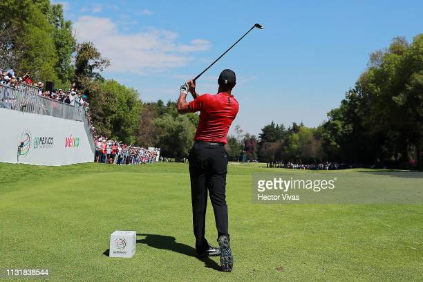 Tiger Woods of the United States plays his shot from the first tee during the final round of World Golf Championships-Mexico Championship at Club de...